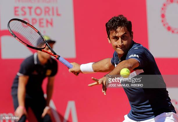Spanish player Nicolas Almagro returns a ball to his compatriot Pablo Carreno Busta during the Estoril Open Tennis tournament in Estoril on May 1...