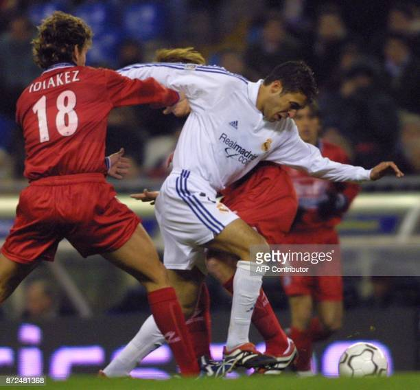 Spanish player of Real Madrid Raul fights for the ball with Idiakez of Real Sociedad during their first division football match in Madrid 15 December...