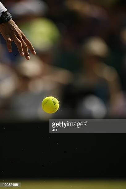 Spanish player Rafael Nadal serves a ball to German player Philipp Petzschner during the Wimbledon Tennis Championships at the All England Tennis...