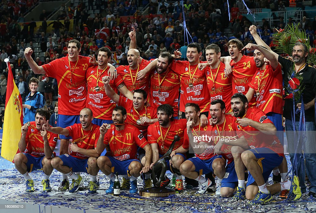 Spanish players celebrate their victory and their gold medal after the Men's Handball World Championship 2013 final match between Spain and Denmark at Palau Sant Jordi on January 27, 2013 in Barcelona, Spain.