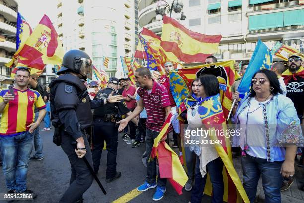Spanish police officer tries to disperse rightwing nationalists amid a counter demonstration in support of Catalan independence in Valencia on...