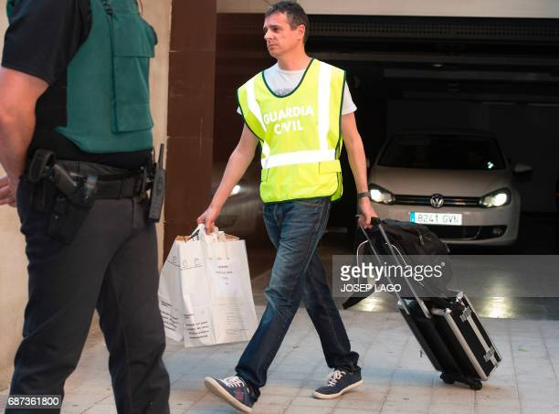 Spanish police officers carry bags seized at the house of former Barcelona's football club president Sandro Rosell after he was arrested in a money...
