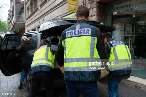 Spanish police officers put in a car boxes seized at Catalan former regional President Jordi Pujol's home in Barcelona on April 26 2017 Historic...
