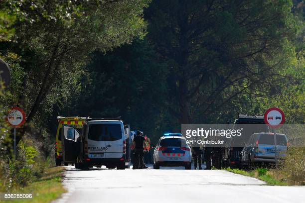 Spanish policemen and members of TEDAXNRBQ arrive at the site where Moroccan suspect Younes Abouyaaqoub was shot on August 21 2017 near Sant Sadurni...