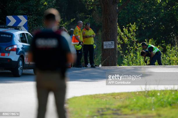 Spanish policemen check the site where Moroccan suspect Younes Abouyaaqoub was shot on August 21 2017 near Sant Sadurni d'Anoia south of Barcelona...