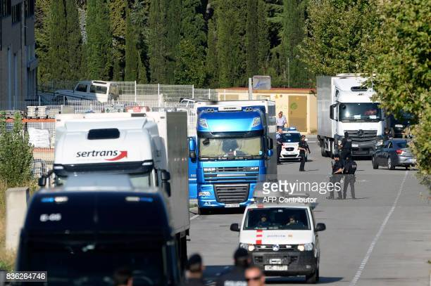 Spanish policemen control the road to the site where Moroccan suspect Younes Abouyaaqoub was shot on August 21 2017 near Sant Sadurni d'Anoia south...