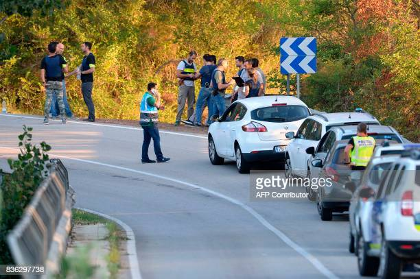 Spanish policemen gather at the site where Moroccan suspect Younes Abouyaaqoub was shot on August 21 2017 near Sant Sadurni d'Anoia south of...