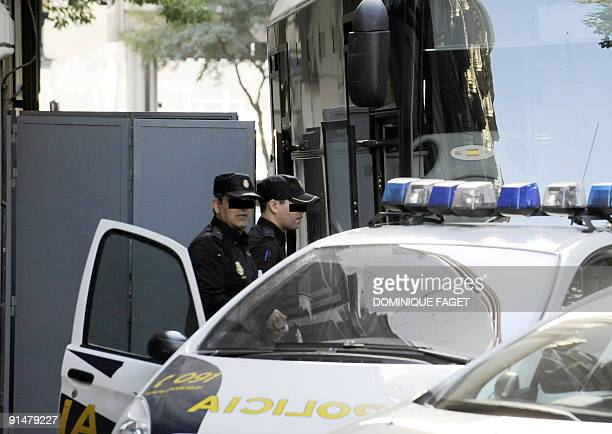 Spanish policemen stand in front of a Police truck used to transport Argentinian born Dutch pilot Julio Alberto Poch to the high court in Madrid on...