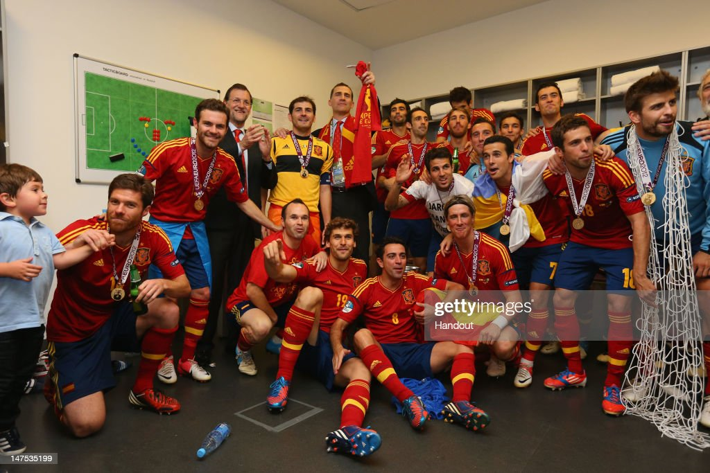 Spanish president Mariano Rajoy and Prince Felipe of Spain pose with the Spain team in the dressing room and following the UEFA EURO 2012 final match between Spain and Italy at the Olympic Stadium on July 1, 2012 in Kiev, Ukraine.