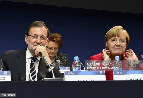 Spanish Prime Minister and leader of the rightwing PP Mariano Rajoy and German Chancellor and CDU federal chairwoman Angela Merkel attend the...