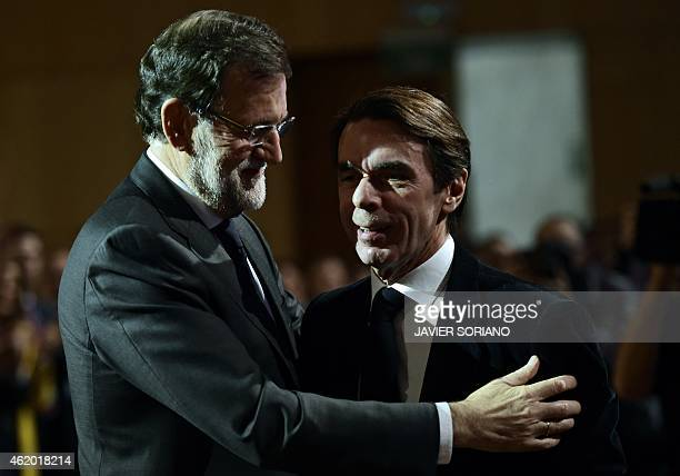 Spanish Prime Minister and Popular Party President Mariano Rajoy embraces Spanish former Prime Minister and Popular Party honorary president Jose...