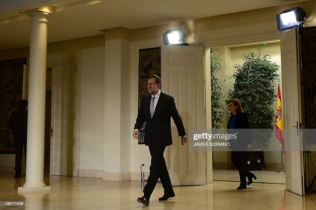 Spanish Prime Minister and PP (Popular Party) leader Mariano Rajoy (L), followed by Spain's First deputy prime minister, government spokeswoman and minister of the prime minister's office Soraya Saenz de Santamaria arrives prior to giving a press conference at the Moncloa Palace in Madrid on December 28, 2012.