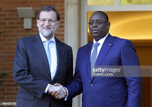 Spanish Prime Minister and PP leader Mariano Rajoy poses with Senegalese President Macky Sall as he arrives at the Moncloa palace in Madrid on...