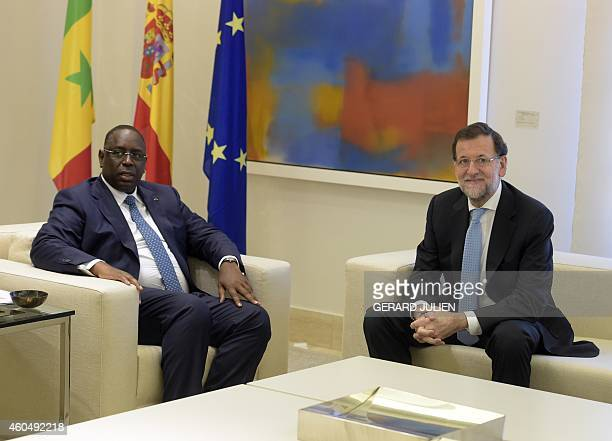 Spanish Prime Minister and PP leader Mariano Rajoy poses with Senegalese President Macky Sall at the Moncloa palace in Madrid on December 15 2014 AFP...