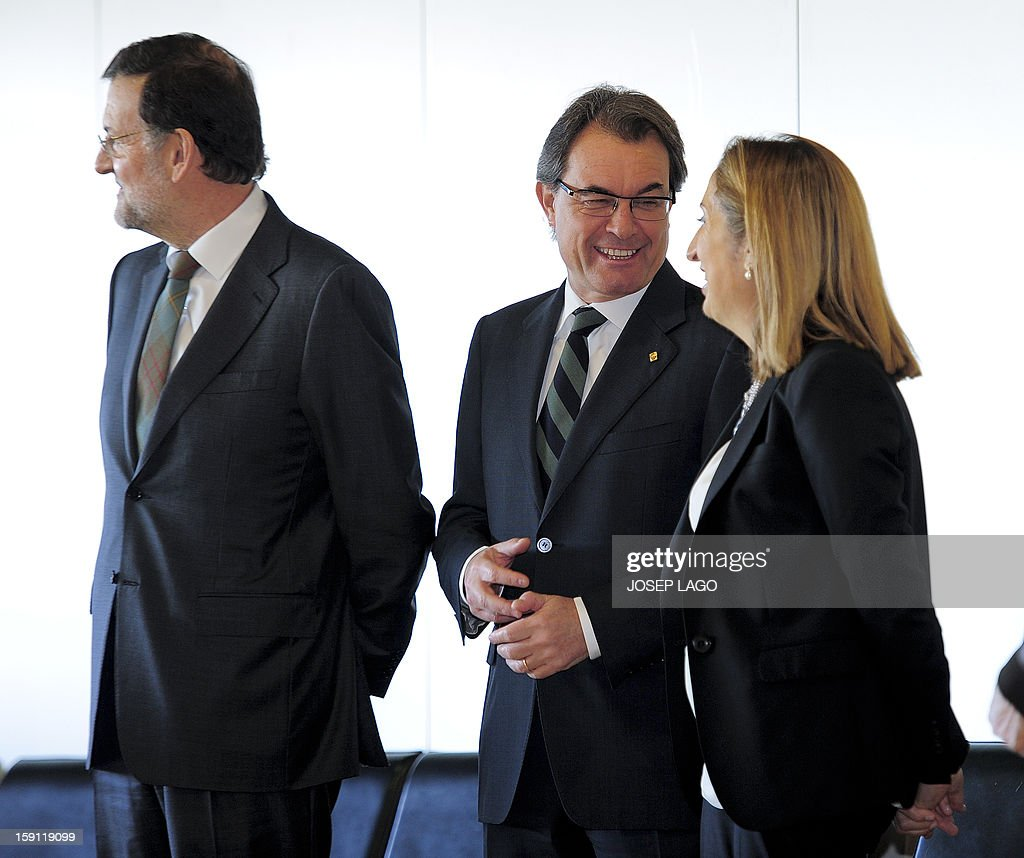 Spanish Prime Minister and PP (Popular Party) leader Mariano Rajoy, president of the Catalonia regional government and leader of the Catalan party CIU (Convergence and Unity party) Artur Mas and Spain's Minister of Development Ana Pastor prior to getting onboard a train at Sants, Barcelona's train station, during the inauguration of the high-speed line between Barcelona and the french border, on January 8, 2013.