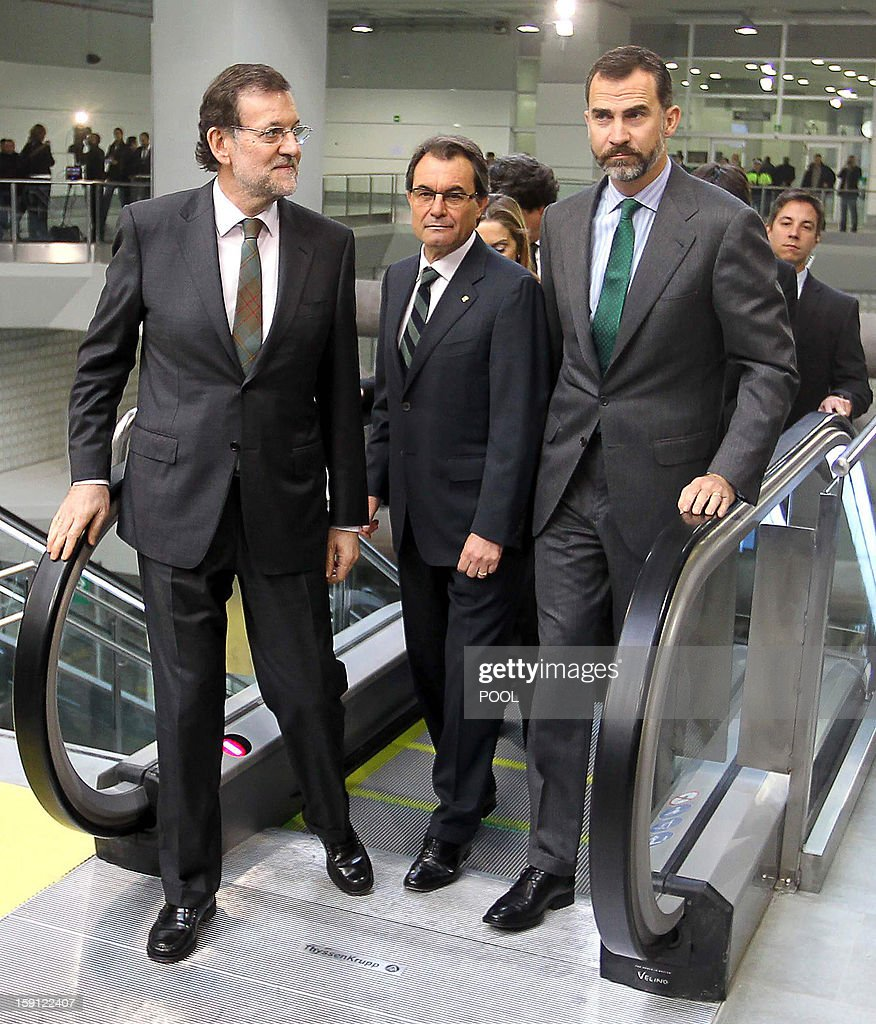 Spanish Prime Minister and PP (Popular Party) leader Mariano Rajoy, President of the Catalonia regional government and leader of the Catalan party CIU (Convergence and Unity party) Artur Mas and Spain's Prince Felipe arrive at Girona's train station, northeastern Spain during the inauguration of the high-speed line between Barcelona and the french border, on January 8, 2013.