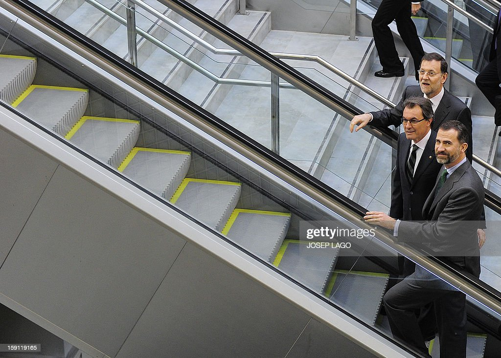 Spanish Prime Minister and PP (Popular Party) leader Mariano Rajoy, Spain's Prince Felipe, president of the Catalonia regional government and leader of the Catalan party CIU (Convergence and Unity party) Artur Mas arrive at Girona station prior to getting onboard a train back to Sants, Barcelona's train station, during the inauguration of the high-speed line between Barcelona and the french border, on January 8, 2013.