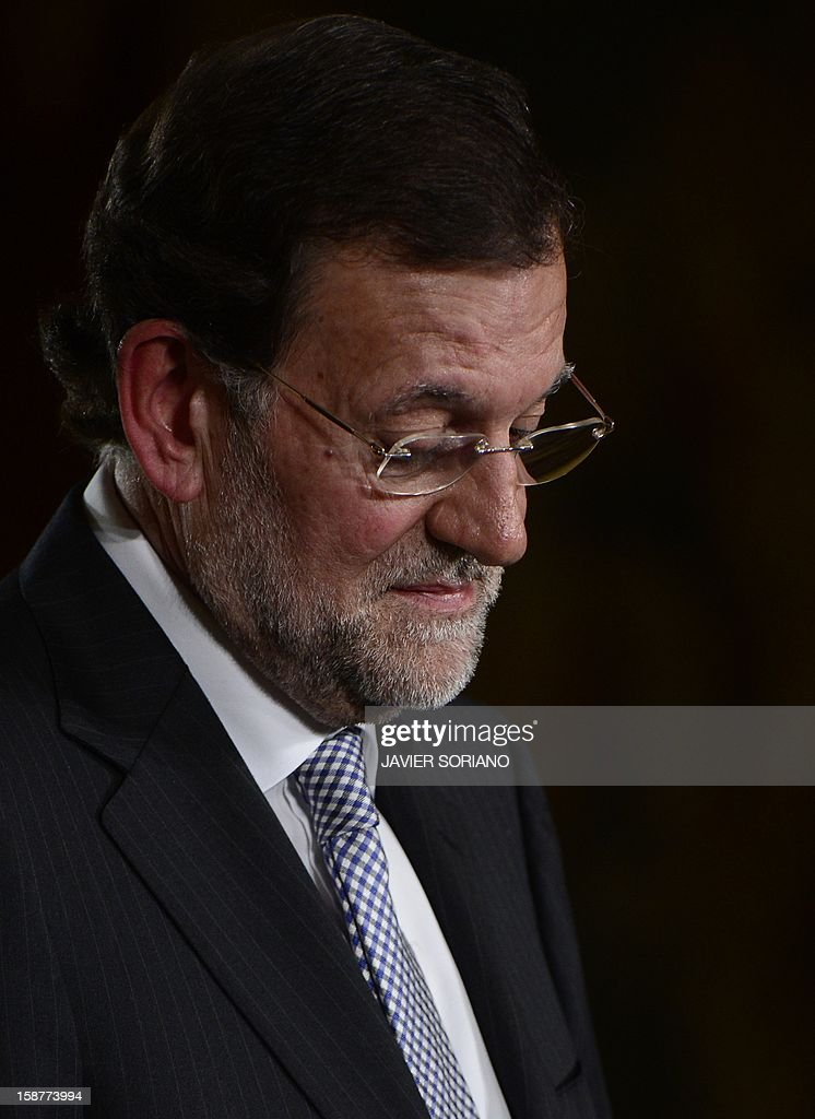 Spanish Prime Minister and PP (Popular Party) leader Mariano Rajoy speaks during a press conference at the Moncloa Palace in Madrid on December 28, 2012. Rajoy warned today of a 'very tough' year ahead for the recession-struck economy but said he hoped for an improvement in the second half of 2013. AFP PHOTO/ JAVIER SORIANO