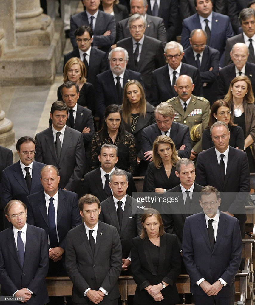 Spanish Prime Minister leader Mariano Rajoy (BottomR) attends a memorial service for the victims the derailed train of Angrois, at the cathedral of Santiago de Compostela on July 29, 2013. The driver of a train that hurtled off the rails in Spain was charged on July 28 with 79 counts of reckless homicide and released on bail after being questioned by a judge.