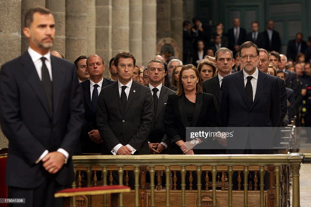 Spanish Prime Minister leader Mariano Rajoy (R) attends the memorial service for the victims the derailed train of Angrois, at the cathedral of Santiago de Compostela on July 29, 2013. The driver of a train that hurtled off the rails in Spain was charged on July 28 with 79 counts of reckless homicide and released on bail after being questioned by a judge.