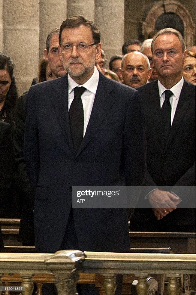 Spanish Prime Minister leader Mariano Rajoy attends the memorial service for the victims the derailed train of Angrois, at the cathedral of Santiago de Compostela on July 29, 2013. The driver of a train that hurtled off the rails in Spain was charged on July 28 with 79 counts of reckless homicide and released on bail after being questioned by a judge.