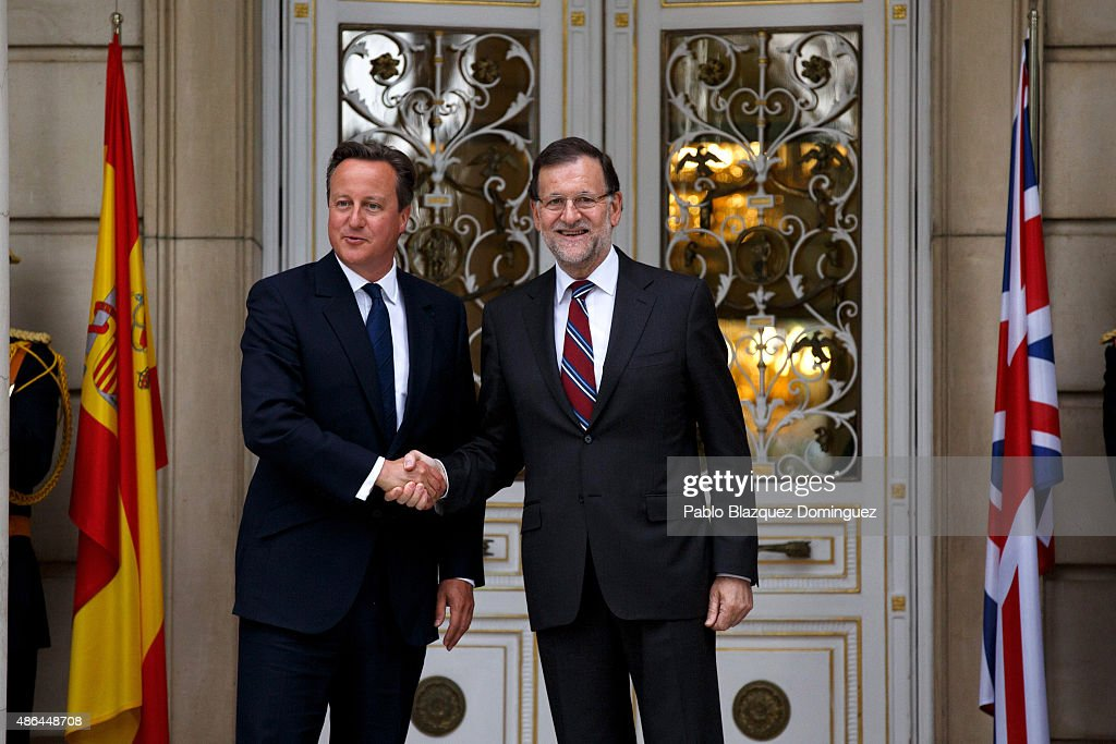 Spanish Prime Minister Mariano Rajoy and British Prime Minister David Cameron shake hands in front of photographers as they meet at Moncloa Palace on...