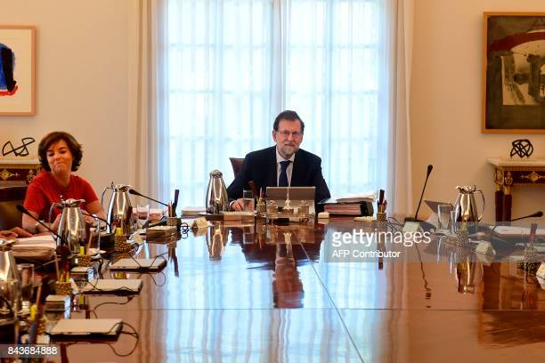 Spanish Prime Minister Mariano Rajoy and Deputy Prime Minister Soraya Saenz de Santamaria attend a cabinet meeting at La Moncloa palace in Madrid on...