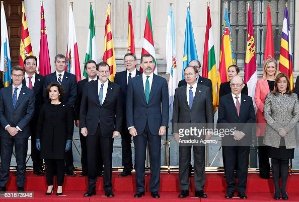 Spanish Prime Minister Mariano Rajoy and Felipe VI of Spain pose for a photo with the Presidents of 17 autonomous governments at the Senate in Madrid...