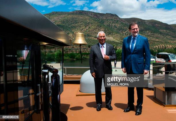 Spanish Prime Minister Mariano Rajoy and his Portuguese counterpart Antonio Costa pose on the 'MS Douro Elegance' ship on the first day of the XXIX...