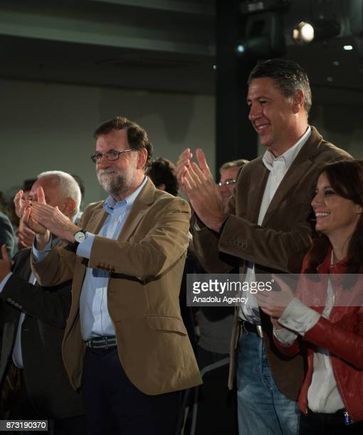 Spanish Prime Minister Mariano Rajoy and Leader of the Catalan Popular Party Xavier Garcia Albiol applause during their meeting in Barcelona Spain on...