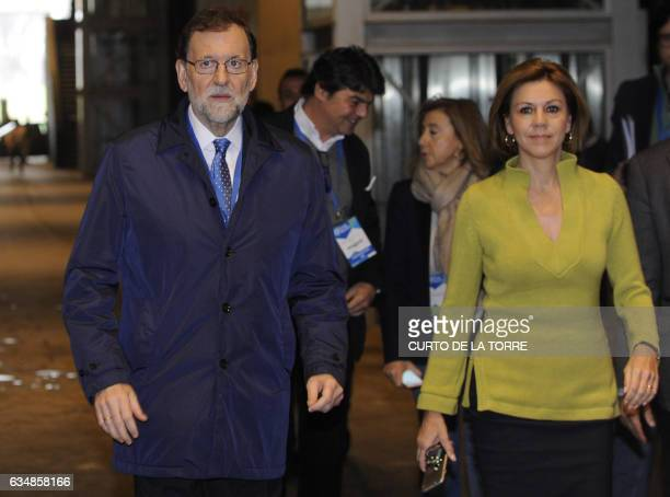 Spanish Prime Minister Mariano Rajoy and PP Secretary General and Spanish Defense minister Maria Dolores de Cospedal arrive for the closing ceremony...