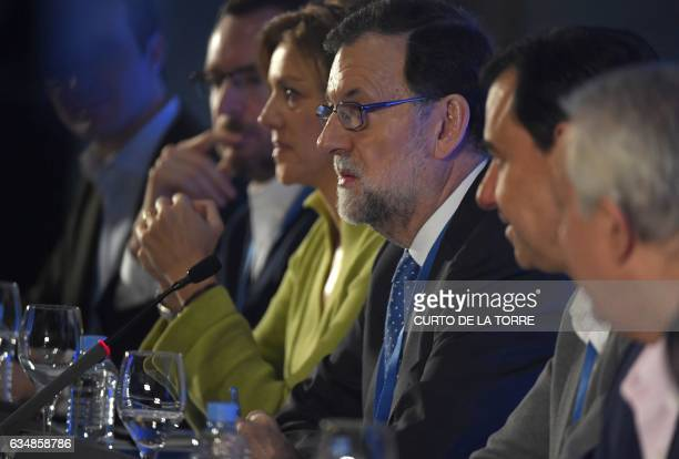 Spanish Prime Minister Mariano Rajoy and PP Secretary General and Spanish Defense minister Maria Dolores de Cospedal attend the closing of the the...
