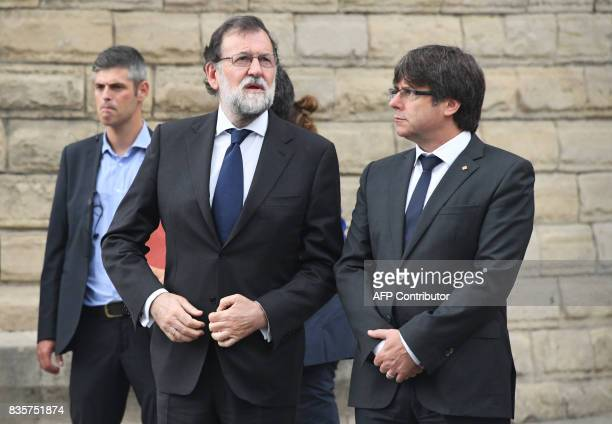 Spanish Prime Minister Mariano Rajoy and President of Catalonia Carles Puigdemon arrive for a mass to commemorate victims of two devastating terror...