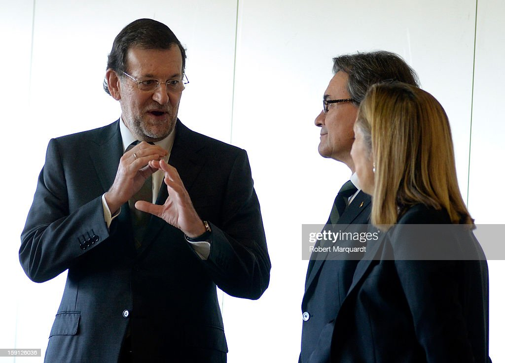 Spanish Prime Minister Mariano Rajoy and President of Catalunya Artur Mas arrive at the Barcelona Sants train station for the inauguration of the AVE high-speed train line between Barcelona and the French border on January 8, 2013 in Barcelona, Spain.
