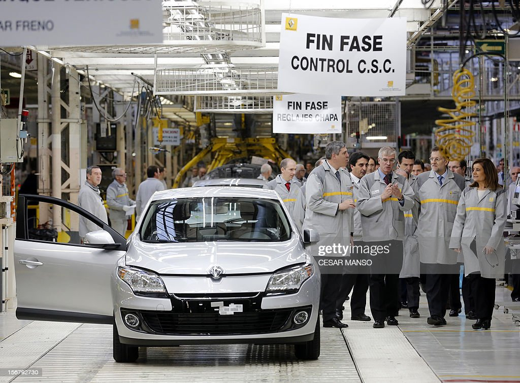 Spanish Prime Minister Mariano Rajoy (2R) and Spain's Minister of Employment and Social security Maria Fatima Banez Garcia (R) visit the Villamuriel Renault factory in northern Spain on November 21, 2012. French car maker Renault plans to create 1,300 jobs at its factories in recession-hit Spain, Spanish Prime Minister Mariano Rajoy said. Renault has an industrial plan to develop its Spanish plants which will involve 'the creation of 1,300 new jobs', Rajoy said.