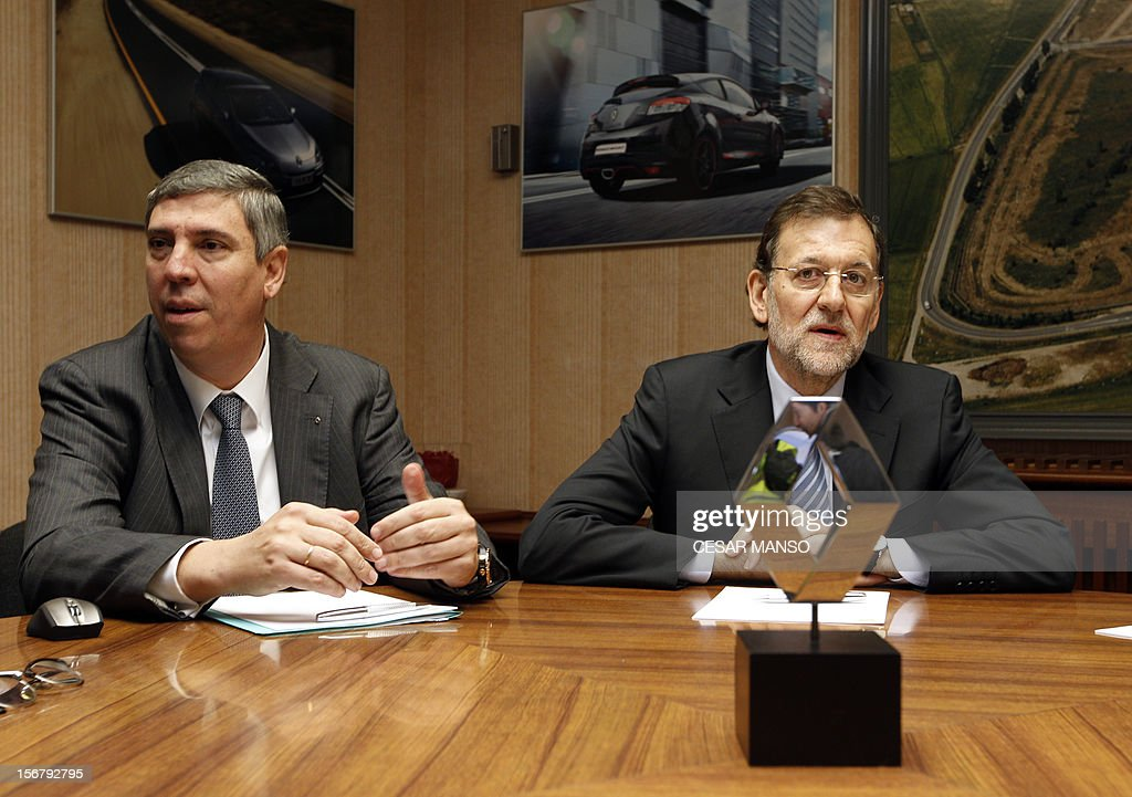 Spanish Prime Minister Mariano Rajoy (R) and the President of Renault Spain Jose Vicente de los Mozos (L) meet at the Villamuriel Renault factory in northern Spain on November 21, 2012. French car maker Renault plans to create 1,300 jobs at its factories in recession-hit Spain, Spanish Prime Minister Mariano Rajoy said. Renault has an industrial plan to develop its Spanish plants which will involve 'the creation of 1,300 new jobs', Rajoy said. AFP PHOTO / CESAR MANSO
