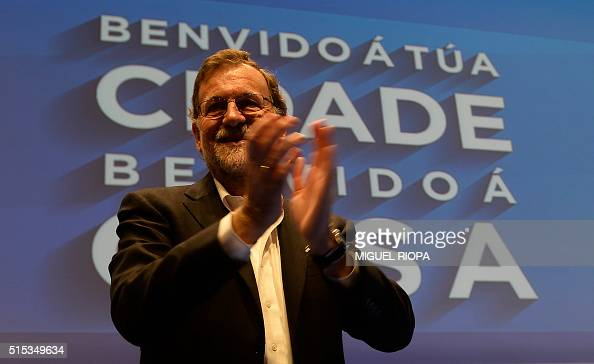 Spanish Prime Minister Mariano Rajoy applauds after arriving at the Popular Party's local congress in Pontevedra northwesten Spain on March 13 2016 /...