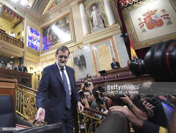 Spanish Prime Minister Mariano Rajoy arrives to his seat at the Congress of Deputies in Madrid on June 13 2017 before a vote of no confidence tabled...