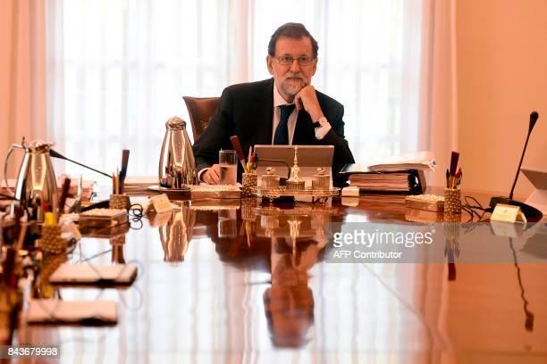 Spanish Prime Minister Mariano Rajoy attends a cabinet meeting at La Moncloa palace in Madrid on September 7 2017 The Spanish government is to hold...