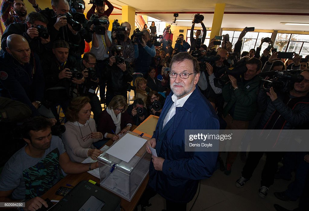 Spanish Prime Minister Mariano Rajoy casts his vote during General Elections at a polling station on December 20, 2015 in Madrid, Spain. Spaniards went to the polls today to vote for 350 members of the parliament and 208 senators. For the first time since 1982, the two traditional Spanish political parties, right-wing Partido Popular (People's Party) and centre-left wing Partido Socialista Obrero Espanol PSOE (Spanish Socialist Workers' Party), held a tight election race with two new contenders, Ciudadanos (Citizens) and Podemos (We Can) attracting right-leaning and left-leaning voters respectively.