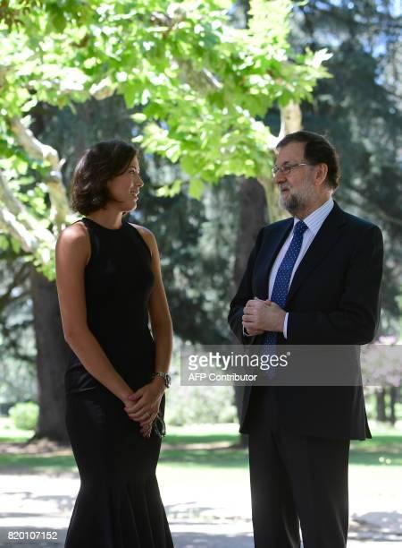Spanish Prime Minister Mariano Rajoy chats with SpanishVenezuelan tennis player Garbine Muguruza at La Moncloa palace in Madrid on July 21 2017 The...