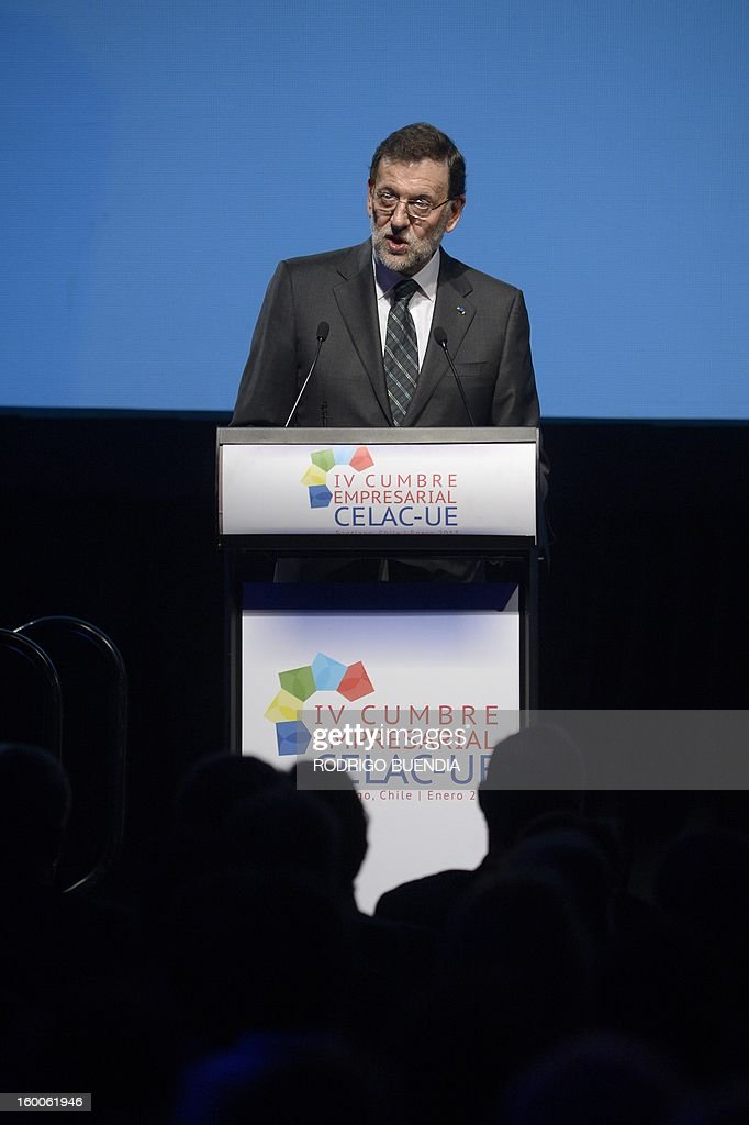 Spanish Prime Minister Mariano Rajoy delivers a speech during the opening of the IV Business Meeting in the framework of the weekend's two-day CELAC-EU Summit in Santiago, during his official visit to Chile on January 25, 2013. More than 40 Heads of State and Government of the Community of Latin American and Caribbean States (CELAC) and the European Union (EU) will meet on January 26 and 27 to promote a strategic partnership between the two regions.