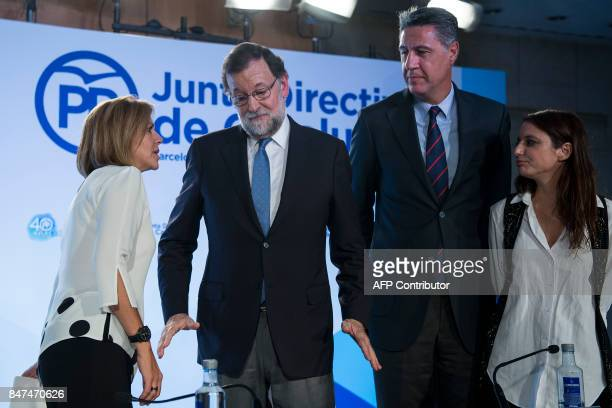 Spanish Prime Minister Mariano Rajoy gestures next tpo Popular Party of Catalonia spokesman Xavier Garcia Albiol Spain's Defence Minister Maria...