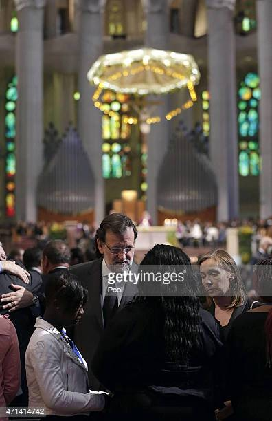Spanish Prime Minister Mariano Rajoy gives his condolences to victim's relatives as he attends the state funeral service for the victims of the...