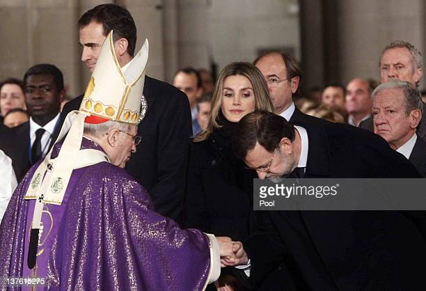 Spanish Prime Minister Mariano Rajoy greets Archbishop Antonio Maria Rouco Varela of Madrid as Prince Felipe of Spain and Princess Letizia of Spain...