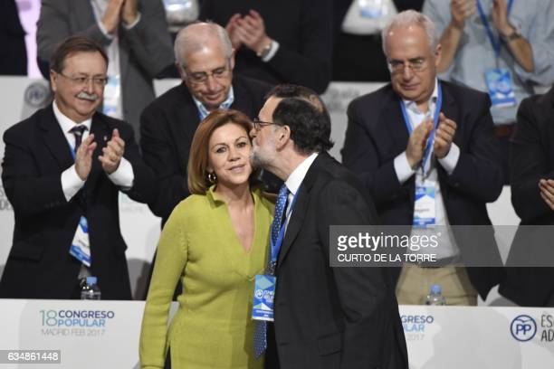 Spanish Prime Minister Mariano Rajoy kisses PP Secretary General and Spanish Defense minister Maria Dolores de Cospedal during the closing ceremony...