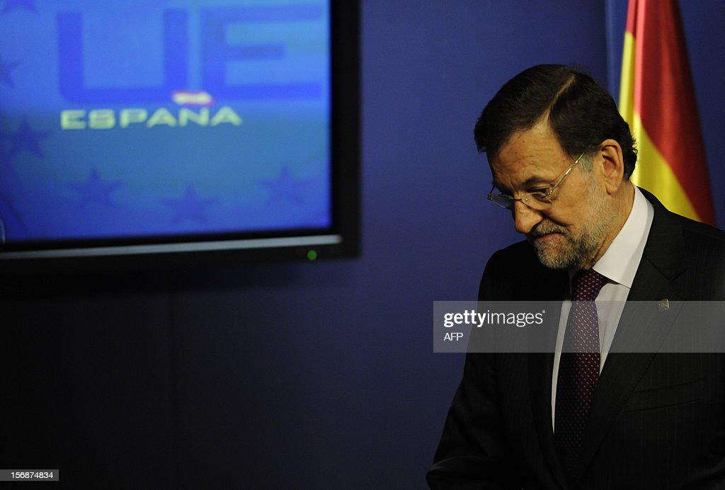 Spanish Prime Minister Mariano Rajoy leaves after he gave a press conference at the EU Headquarters, on November 23, 2012 in Brussels, after a two-day European Union leaders summit called to agree a hotly-contested trillion-euro budget through 2020. EU Council President Herman Van Rompuy said today that an EU budget deal was within reach early next year, after a two-day summit collapsed without agreement.