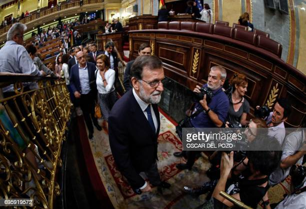 Spanish Prime Minister Mariano Rajoy leaves the Congress of Deputies in Madrid on June 14 2017 after a vote of no confidence tabled by the farleft...
