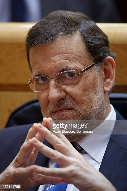 Spanish Prime Minister Mariano Rajoy listens during a Parliament session over allegations on corruption scandals on August 1 2013 in Madrid Spain...