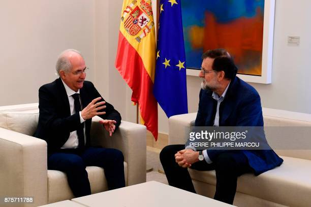 Spanish Prime Minister Mariano Rajoy listens to former Caracas mayor Antonio Ledezma during a meeting in Madrid on November 18 2017 Ledezma arrived...